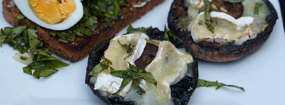 Grilled black mushrooms topped with Camembert.
