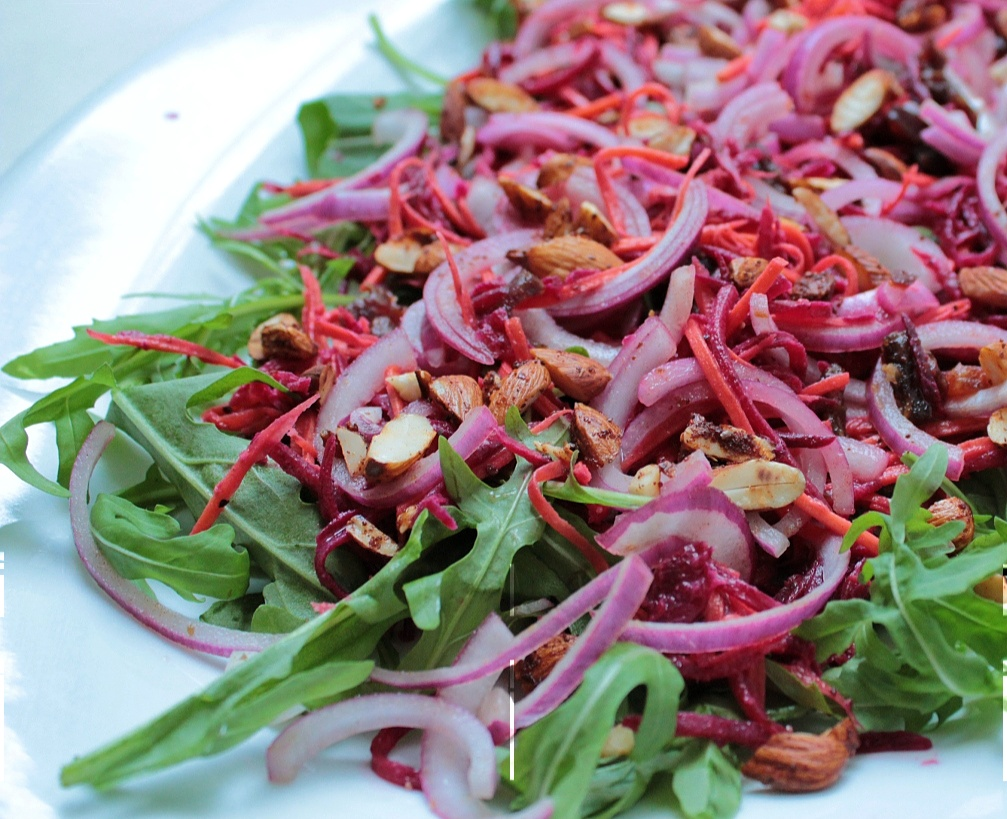 Julienne beetroot and carrot with red onion, almonds and dates on a bed of rocket - this is a combination of two recipes with a few adaptations according to what I could find at Pick n Pay